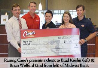 Photo_Raising_Cane's_Donating_Midwest_Bank_Pilger_Check_Lincoln_Nebraska