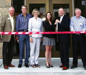 HOME Real Estate - Ribbon cutting photo