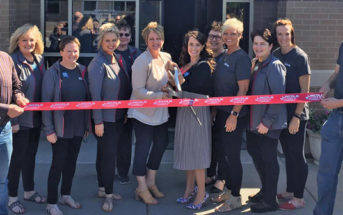 Complete Hearing Ribbon Cutting