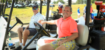 Golfing responsibly, Chuck Clifford and Tim Wacker wish each other luck through air fist pumps while practicing social distancing and safely gearing up to play.